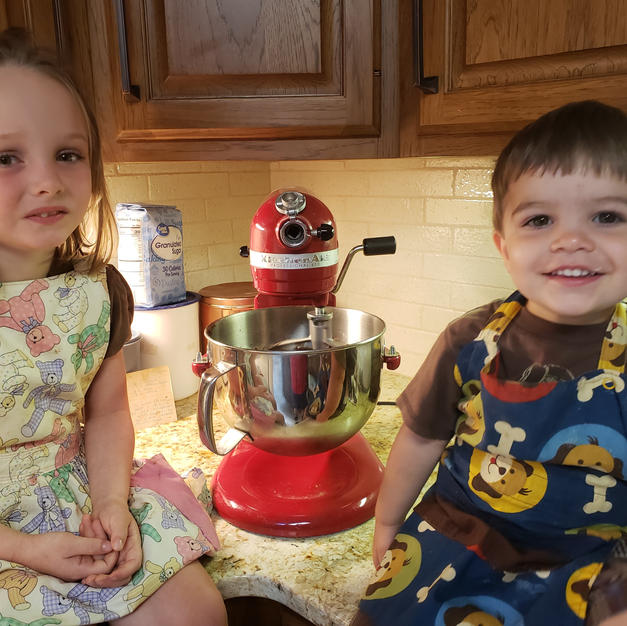 Callie & Ezra cooking with Nana. I sewed their aprons!