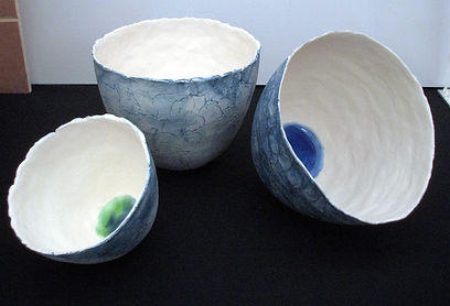 9 porcelain bowls with glass.jpg