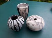 naked raku, horsehair and white glazed pots.jpg