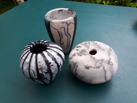 naked raku, horsehair and white glazed pots.jpg