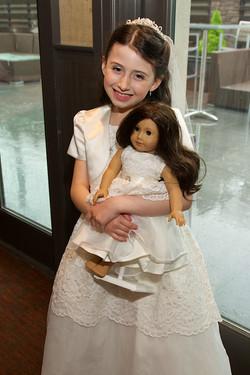 Emma communion with doll
