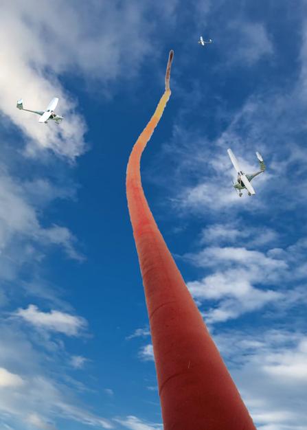 Regenboog met vliegtuigje