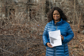 City Council Candidate Lauren Carter visits Lake Isle Dam