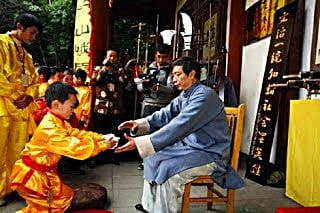 Serving Chinese tea to elders & guests shows respect...