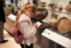 girl at a museum enjoying the art and artifacts
