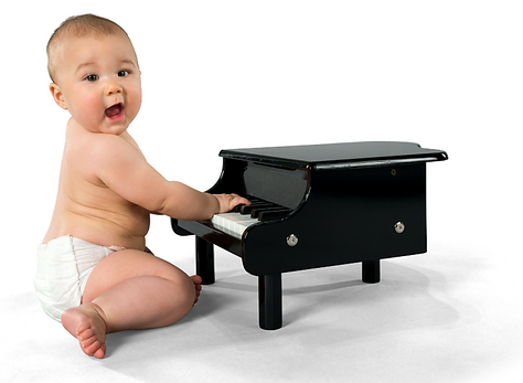 baby making sounds on a piano: listening habits begin at birth
