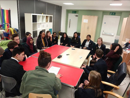 How can young people in Trafford help tackle racism on a local scale?