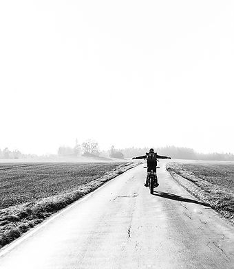 Cyclist on an open road