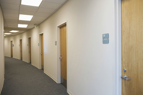 View of an empty corridor with closed do
