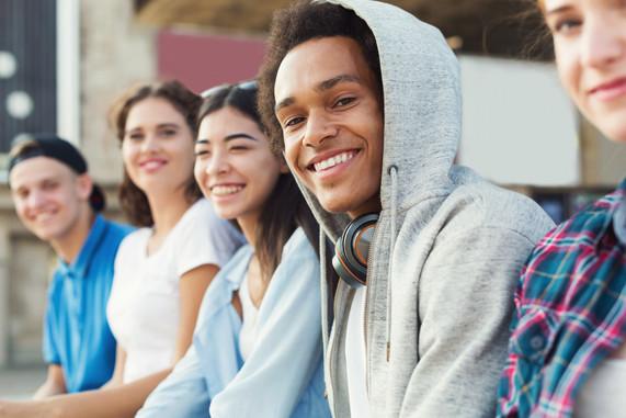 Multiethnic teen company spending time t