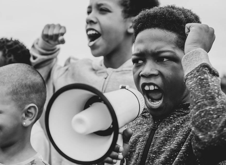 Young boy shouting on a megaphone in a p