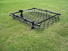 Three point MaxiLift chain harrow thatches grass