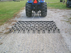 Standard Drag Harrow maintaining a gravel driveway