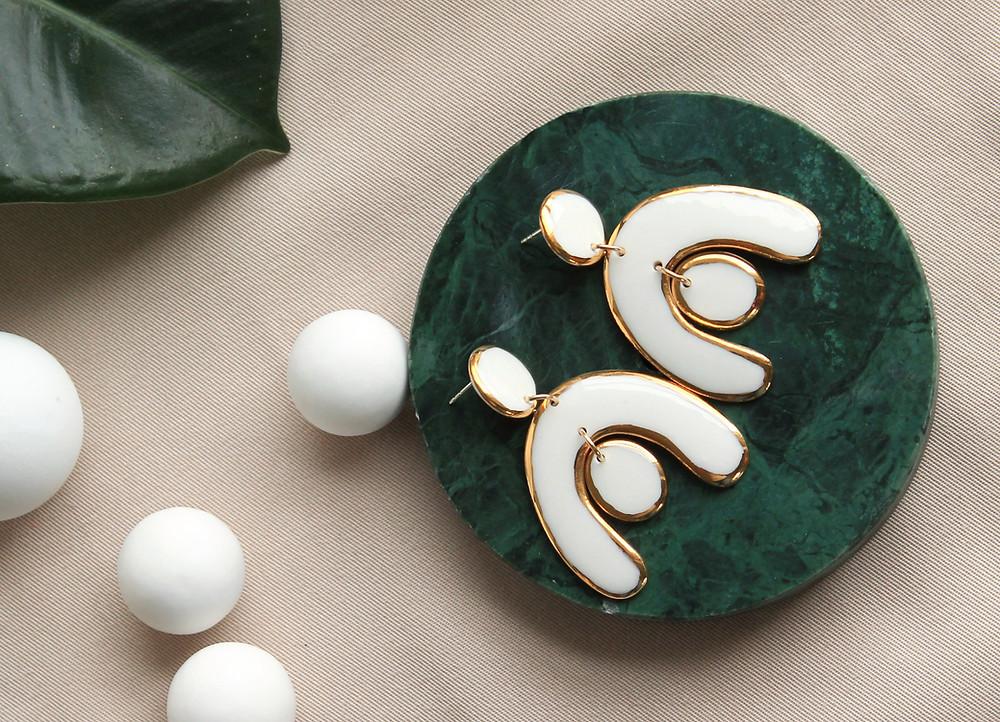 White statment earrings