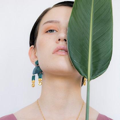 Green statement earrings