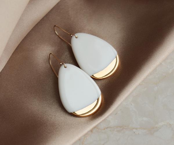 White teardrop shape porcelain earrings dripped in gold