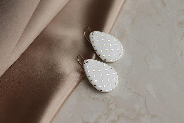 With polka dot earrings