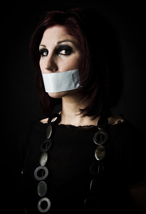 Artistic portrait of woman with tape ove