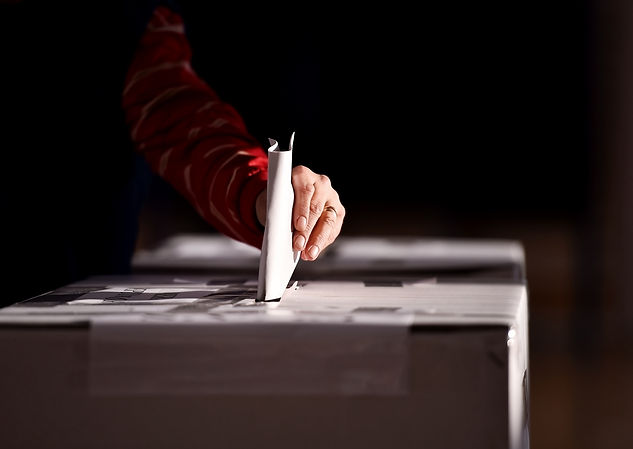 Hand of a person casting a vote into the