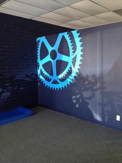 Gear Logo @ Empower Cycling Studio
