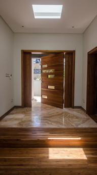 Main access door in hardwood