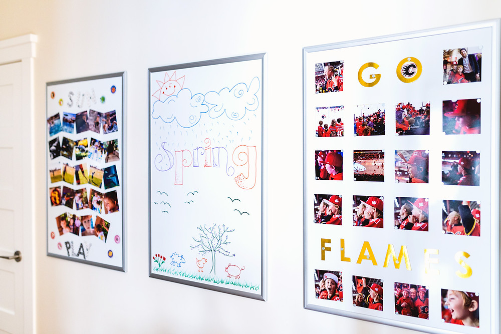 Magnetic whiteboard photo display in hallway