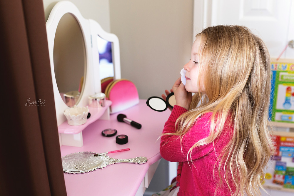 Getting dolled up with her pretend makeup | Medicine Hat Lifestyle Family Photographer