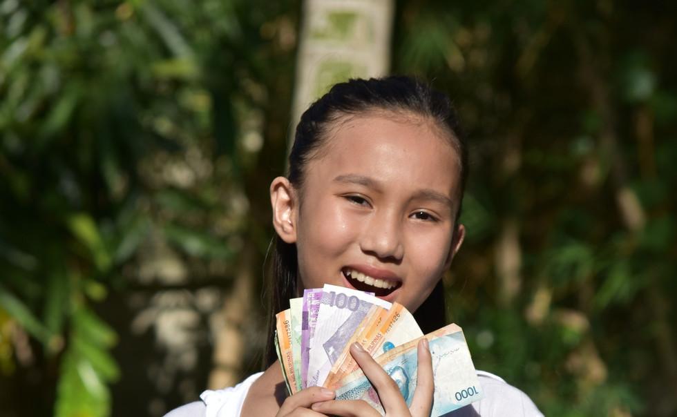 A Youthful Minority Girl With Money.jpg