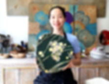 korean woman proudly exhibiting her  achieved lacquerware after a lacquerware worlshop at himapan