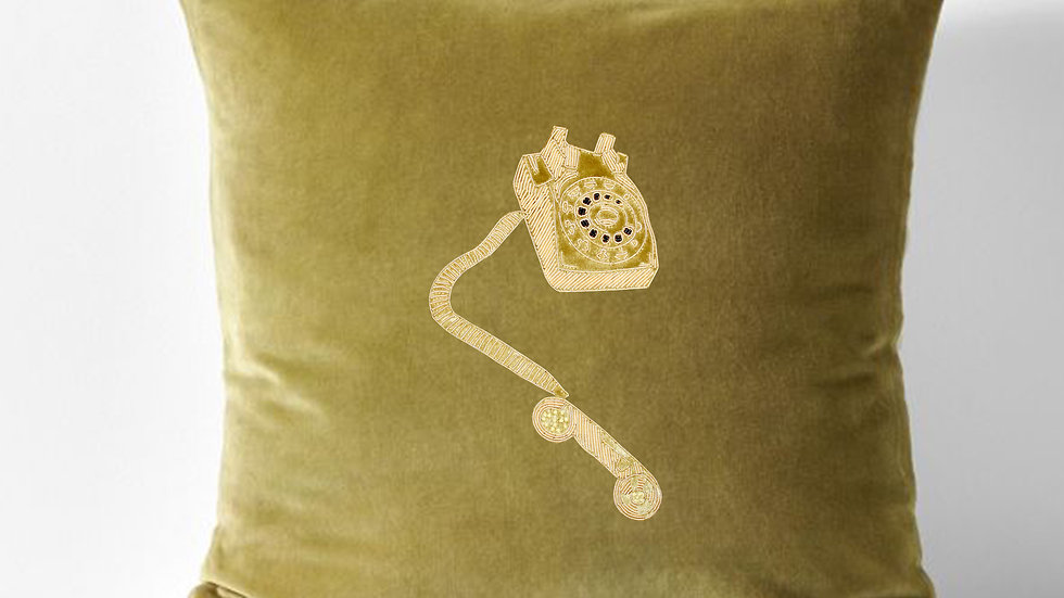 gold work embroidered cushion - hanging over the telephone