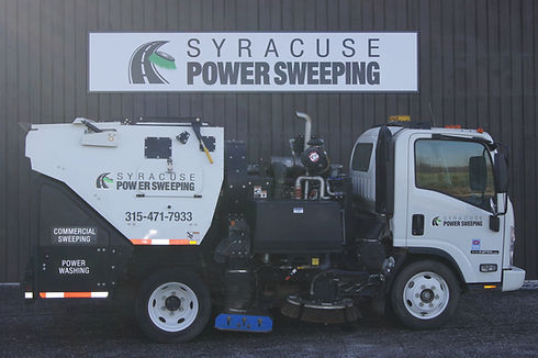 White Sweeper in front of building.JPG