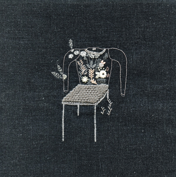 Chair-with-sweater-with-black-garden