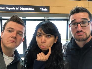 Manuel, Hala, and Eric making sad faces as Eric waits for his train