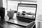Laptop on a serene desk space at home showing a departmental site built on Sharepoint