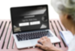 Elderly women with visual impairments using the PRESTO website on a laptop