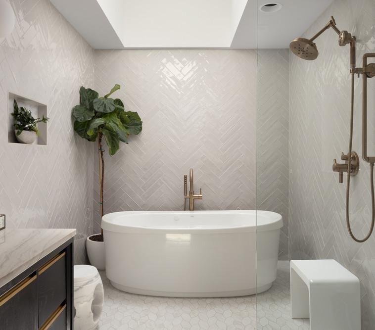 Primary Bathroom, Skylight, jacuzzi tub, herringbone tile work, modern leaf mosaic on the floor