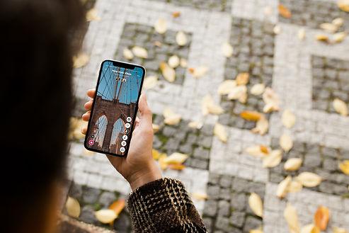 mockuuups-walking-with-iphone-x-mockup.jpg