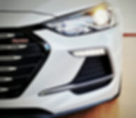 brand new hyundai elantra sport detail photo of front grill and led headlight and also with Turbo badge