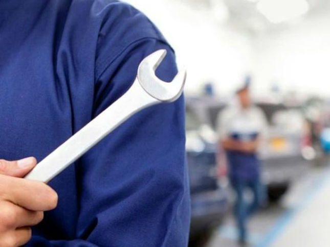 Detail photo of vehicle workshop technician holding a spanner