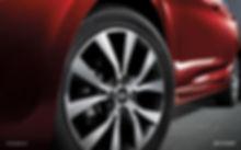 Two tone aloy wheels close up photo.