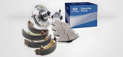 Hyundai genune brake pads, disc and a box of parts