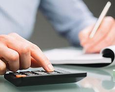 Stock image of man using a calculator.