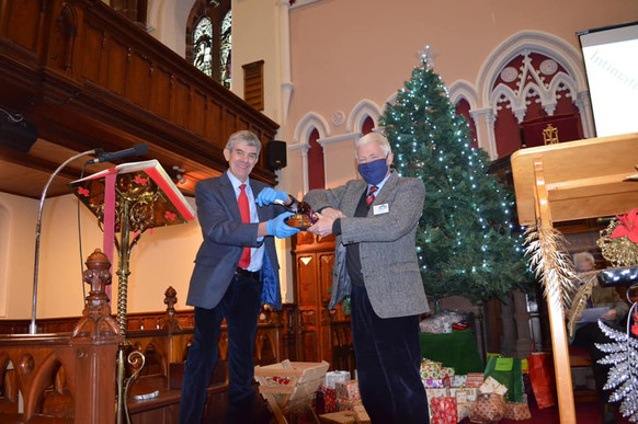 Session Clerk Donald Walker presenting Angus Sinclair with the Millennium Award with praise and thanks for all he and the team at Moffat Town Hall Redevelopment Trust are doing to support the community during the Covid 19 pandemic