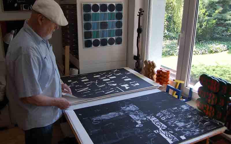 Artist Eduard Ovcacek showing his screen prints in his studio in Ostrava, Czech Republic.