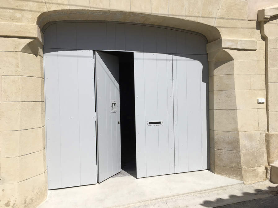 portail repliable 4 panneaux habillage en bois