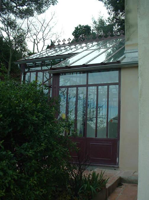 veranda toiture vitrée et décor de faitage