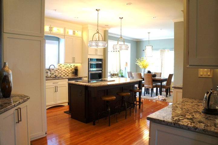 Off White Cabinets with Dark Island & Wood Floor