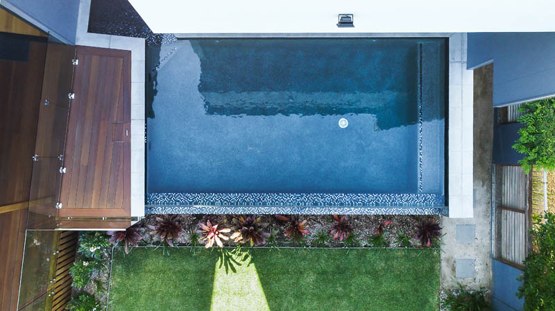 Pool at back of custom built home