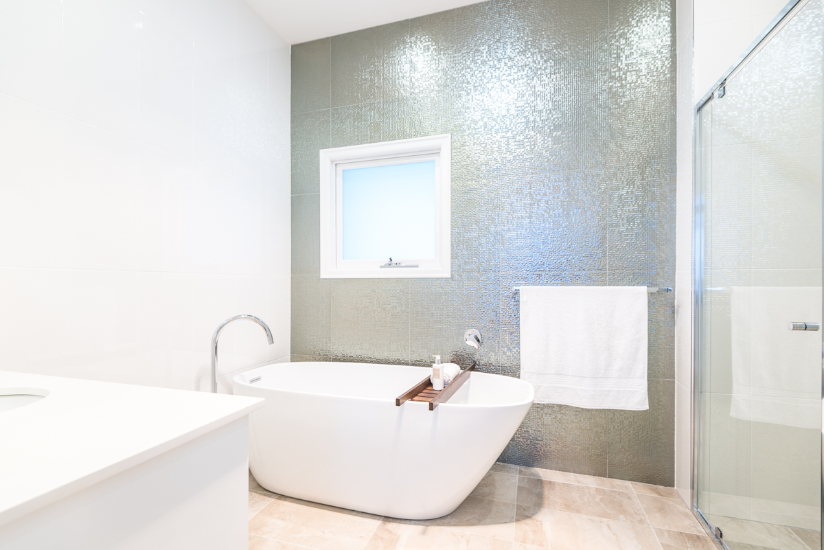 Renovated bathroom with feature tile