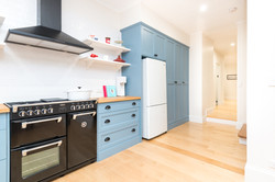 Blue kitchen with timber floor